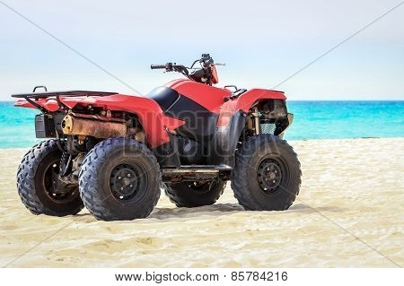 Quad Vehicle On The Beach