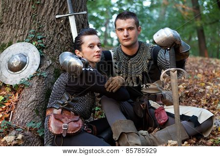 ZAGREB, CROATIA - OCTOBER 07, 2012: Woman and a man dressed in medieval clothes with swords, posing after the
