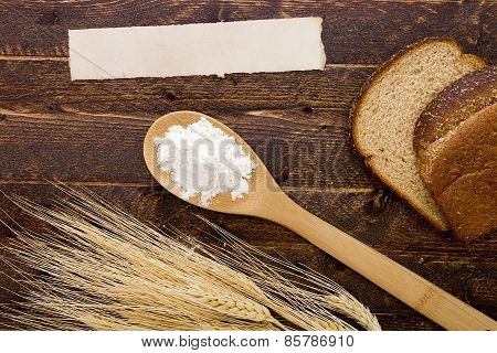 Flour In A Spoon And Bread