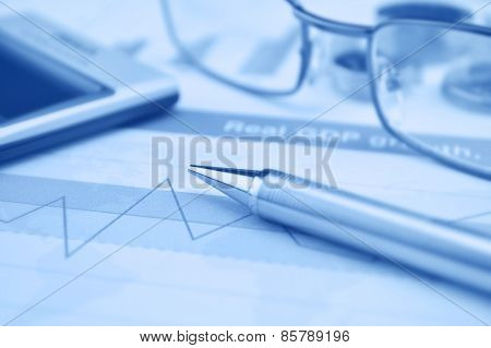 Pen Glasses And Calculator On Financial Chart And Graph, Accounting Background