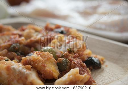 Cod With Olives Capers And Tomato Sauce