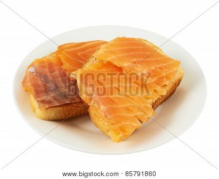 Two salmon sandwiches in a plate