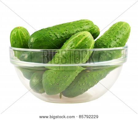 Glass bowl full of cucumbers