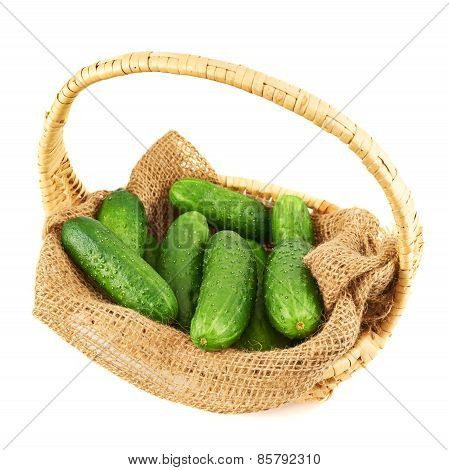 Wicker basket full of cucumbers isolated
