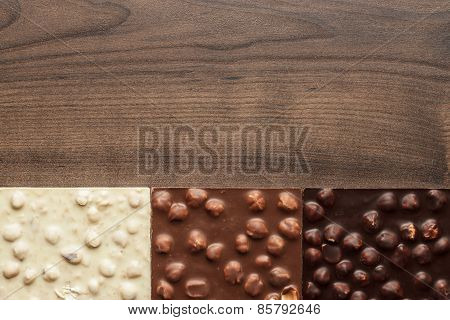different chocolate bars with whole hazelnuts
