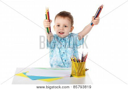 Little Boy Holding A Lot Of Colored Pencils