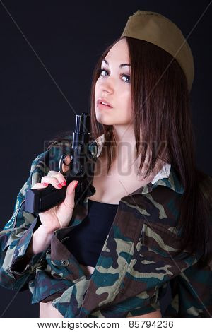 Young Woman In The Military Uniform With The Gun
