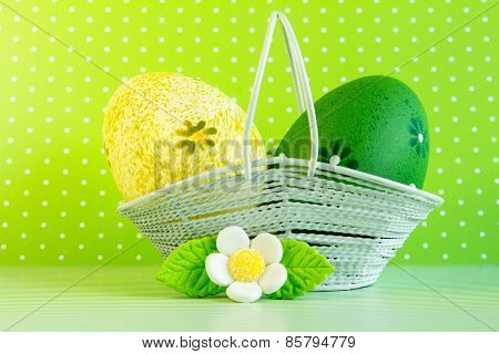Yellow And Green Easter Eggs In A Basket With White Flower