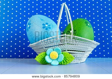 Blue And Green Easter Eggs In A Basket With Blue Flower