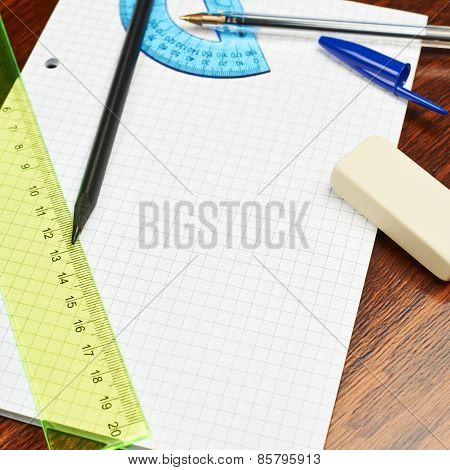 Blank sheet of paper covered with writing appliances