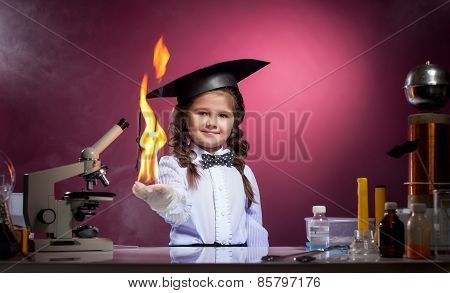 Cute girl conducts physical experience in lab