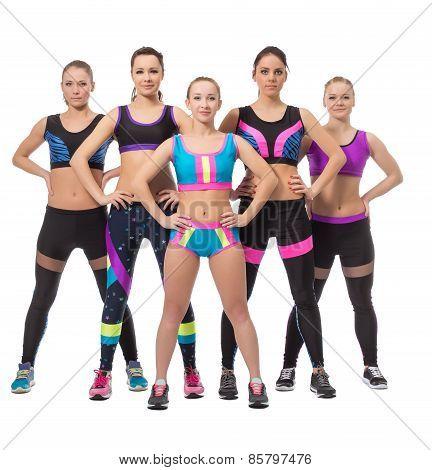 Team of pretty female athletes posing at camera