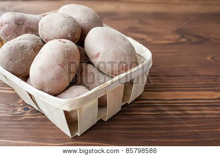 Heart shaped potato and basket with potatoes