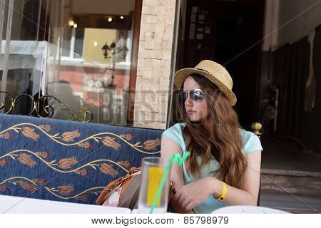 Teen Resting At Outdoor Cafe