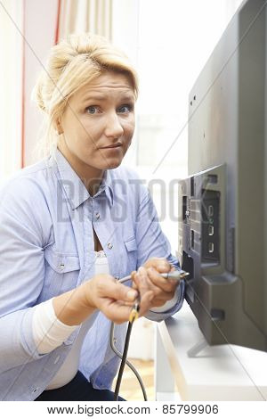 Confused Woman Unsure As To How To Put Leads Into New Television