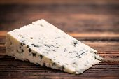 image of penicillin  - Piece of gorgonzola cheese on wooden board - JPG