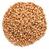 picture of buckwheat  - Wholegrain buckwheat in round heap shape isolated closeup macro top view - JPG
