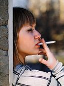 pic of teen smoking  - Young student smoking in front of her school - JPG