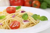 pic of spaghetti  - Spaghetti noodles pasta food meal with tomatoes and basil on plate - JPG