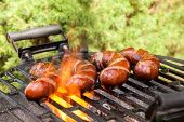 picture of grilled sausage  - Grilling sausages on barbecue grill - JPG