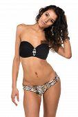 stock photo of slender  - Tall slender brunette in a black bandeau top and leopard print panties - JPG