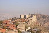stock photo of tilt  - The old fortress of Ankara also known as Ankara Kalesi with the flag of Turkish Republic over it - JPG