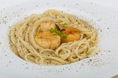 stock photo of scallops  - Pasta with scallops and fresh green herbs - JPG