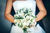 foto of bouquet  - bridal bouquet with white lilies in the hands of the bride - JPG