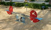 stock photo of seesaw  - photo of  colorful seesaw at children playground - JPG