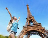 stock photo of freedom tower  - Happy carefree travel woman in Paris with Eiffel Tower asian beauty - JPG
