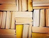 stock photo of bookworm  - image of a stack of paperback books on the end of the pages toned with a retro vintage warm instagram like filter app or action effect - JPG