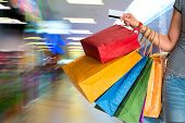 picture of mall  - Woman holding shopping bags and credit card in the shopping mall - JPG