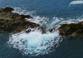 picture of breaker  - The rocks and the wave breakers of the Atlantic ocean at Puerto de la Pena on the island Fuerteventura one of the Canary islands belonging to Spain - JPG