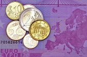 pic of payday  - Several euro coins on a euro banknote - JPG