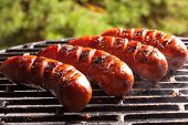 stock photo of grilled sausage  - Grilling sausages on barbecue grill - JPG