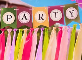 stock photo of ribbon decoration  - Colourful festive swag banner with ribbons for party decoration - JPG