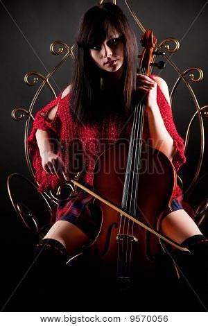 Brunette Girl In Red With Cello