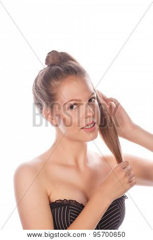 Teen Girl With Nude Makeup Stroking Her Hair.