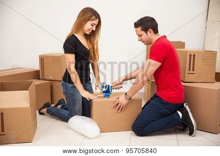 Young Couple Packing Some Boxes