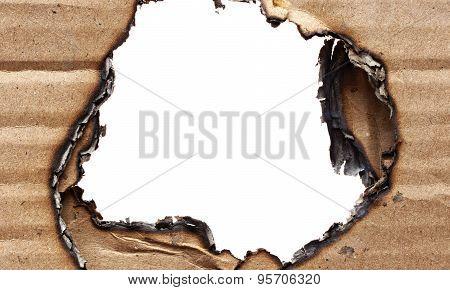 Hole in cardboard