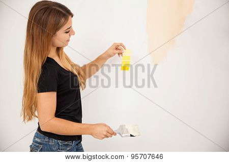 Cute Girl Decorating A Room