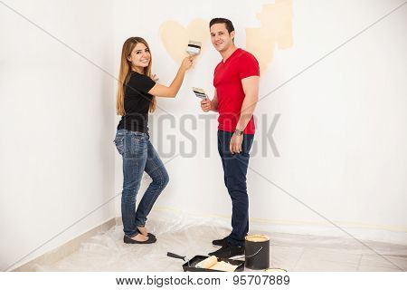 Young Couple In Love Decorating