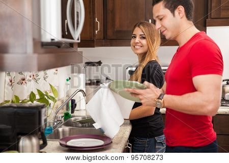 Cute Couple Washing The Dishes