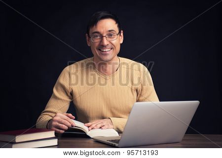 Smiling Handsome Man Reading A Book
