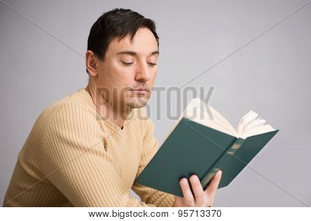 Handsome Young Man Reading A Book