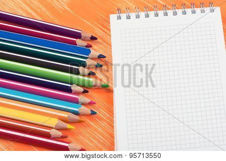 Colour Pencils On Orange Background