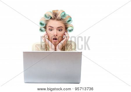 Attractive young woman is using modern notebook