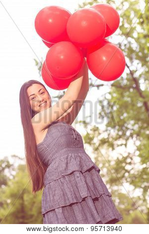 Attractive Young Woman With Red Balloons