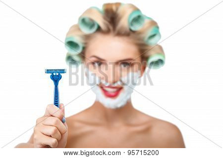 Beautiful young housewife is preparing for shaving