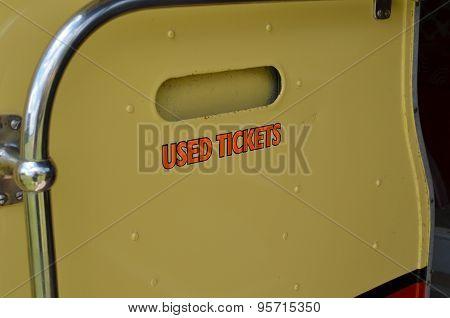 Used tickets bin on public transport bus.